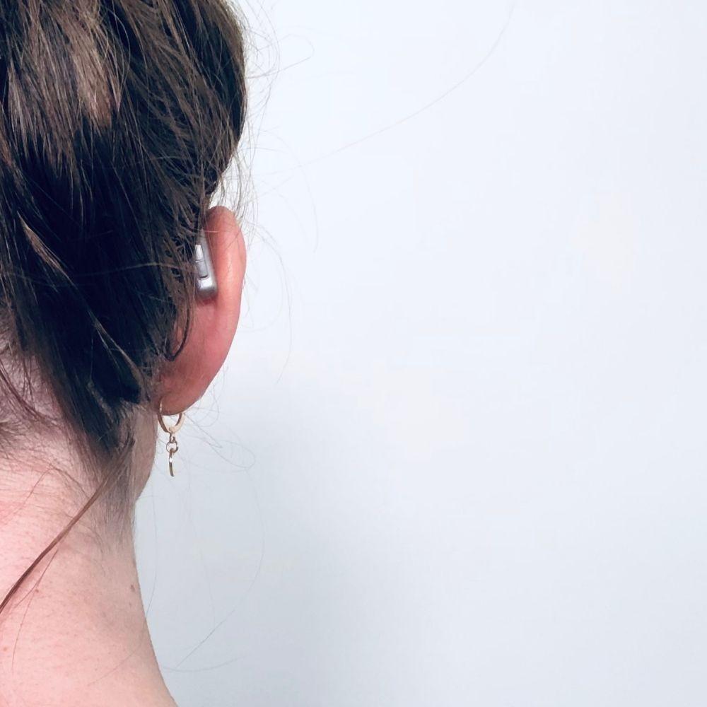 Oticon More Hearing Aids Worn